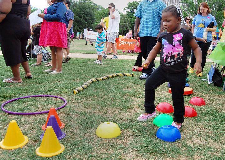Destinee Thompson, then 3, of North Charleston tested her balance at the 2014 Fam Jam in Marion Square. (Photo by Dave Munday/The Post and Courier)